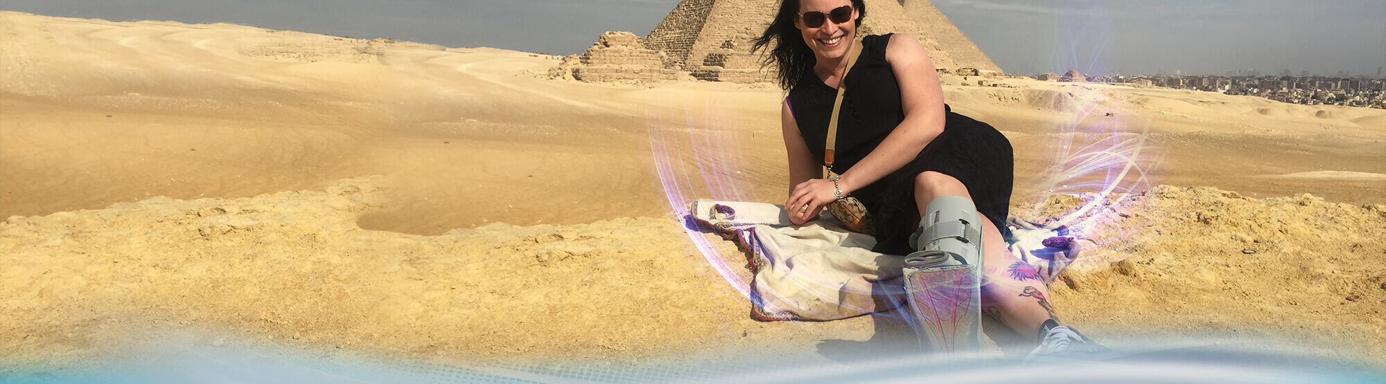 Woman next to pyramid